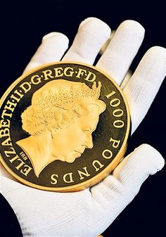 The largest of The Royal Mint's commemorative Royal Christening coins is made of gold   (photo - ANDREW CROWLEY - The Daily Telegraph)