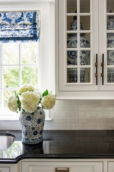 Love how the blue and white fabric compliments the collection of blue and white china in the cabinets! A Palm Beach Regency Style Home- The Glam Pad Kitchen Redo, Kitchen Remodel, Kitchen Black, Kitchen Island, Kitchen Ideas, Kitchen Design, Palm Beach Regency, Inside Cabinets, White Cabinets