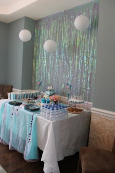 """My little """"Anna"""" """"Elsa"""" 3rd 5th Disney Frozen Winter Wonderland Birthday Party!Here are the Serving Table Decorations; it turned out fun and elegant, all of it easy DIY!"""