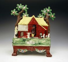 ANTIQUE ENGLISH STAFFORDSHIRE POTTERY FIGURE OF THE RED BARN