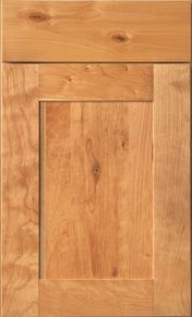 Jacobsen    Full Overlay Wide Rail, Flat Center Panel, SOLID WOOD, Shown in Rustic Alder Natural. Mid Continent Cabinetry