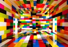 """Valentino Fialdini created a series photographs of bright and colorful rooms and corridors. With the sun streaming through windows and shadows cast on the walls, it almost seems as if you're looking at real rooms, but a closer look reveals that these sterile architectural spaces are, in fact, miniatures built with LEGO bricks and photographed by the artist himself. """"...the spectator is the central character of these spaces based on Reinassance perspective."""""""
