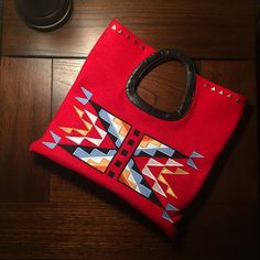 Hand made, 8 band tradecloth clutch with design and thread work.  Flying Horse Designs......Love her work!