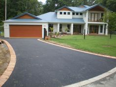 Impact Asphalt featured asphalt driveway with brick edging.