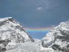 A rainbow bridges Mount Everest and Mount Nuptse - The phenomenon pictured in this photograph is actually not a rainbow at all, but rather a circumzenith arc. It occurs when sunlight refracts through ice crystals high in the atmosphere, bouncing the sun rays back up.