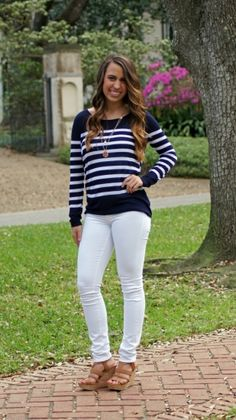 """This navy and white stripe sweater is so soft and silky. Absolutely adorable with white jeans or red shorts. Fits true to size. Chelsea wears a size 0/2 and is 5'3"""". She is wearing a size extra small"""