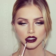 Dark red lips and golden eyes makeup inspiration.