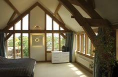 Wraparound windows to oak frame bedroom by Roderick James Architects