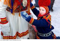 Sami Lapp boy with his Mother at Jokkmokk Winter Fair~by  Jerónimo Lomba