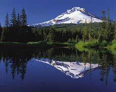 Mout Hood, in Oregon, is also called Wy'east by the Multnomah tribe. It is part of the Cascade Mountain Range. 11,239 feet. Lost Lake pictured in front.
