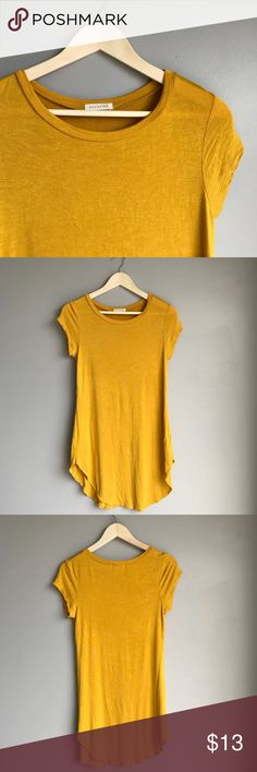 Mustard Yellow Tunic Great top. Depending on how tall you are it might fit more like a dress or a tunic. Tops Tunics