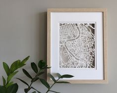 Rome, Italy paper cut map framed in shadowbox with mat. Cut on 100lb bristol smooth paper.  11 x 14 shadowbox frame with glass and white beveled edge mat 8 x 10 cut out space  Choose between white, black or blonde frame.  Ships is 1-3 days