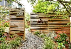 Privacy fence with closely spaced lattice - height depends on slope of the yard.