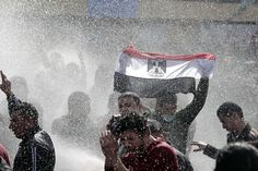 Egypt, people vs. water canon