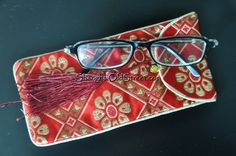 """Beautiful Silk Brocade Eyeglass/Sunglass Pouch/Glasses Protect Bag - Red with Holiday Spirit by Shanghai Old Street. $7.95. Material: 100% silk brocade, thick and sturdier fabric. Beautiful appearance, patterns and color. Fine Quality and Workmanship. Measures: 7"""" x 3.5"""" roomy enough for large sunglasses. Perfect protection for eyeglass and sunglass, nice padded. Need a soft case or pouch that wouldn't take up a lot of room in your purse or pocket? You are gettin..."""
