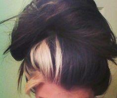 One Blonde streak in a messy bun
