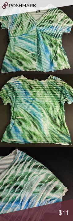 "New Directions Blouse Beautiful V Neck Cascading Beautiful ocean colors in a beautiful abstract coloring similar to tie-dye.  Cascading layers with a Wide V-Neck  97% polyester. 3% spandex comfort stretch.   Excellent condition. Smoke free.   Measurements are taken on the item laying flat.  Chest across at armpits 26"".  Bottom hem flat across 30"".  Length from top of shoulder 29.5"".  Arm opening 9"".   CT1 new directions Tops Blouses"