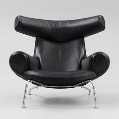 A Hans J Wegner 'Ox-Chair', by AP-stolen, Denmark ca 1961. Reupholstered in black artificial leather