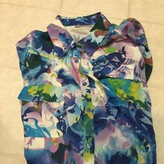 Splatter multicolor long sleeve button blouse! Listing is for a long sleeve multicolor splatter printed button down/ up blouse. Buttons on end of sleeves. This top is beautiful! Can be worn by itself or under a blazer! Make a splash at happy hour or work. Worn about 3 times! Great condition. There are about 6 colors in the blouse so it will go with any shoe!  Pockets in front of shirt. 100% silk great quality very expensive. Price Firm✅ New Nexx York Tops Blouses