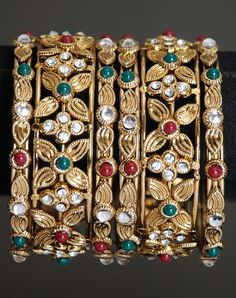 golden color Indian designer bangle set of two big and four small bangles studded with white, red and green color stones