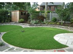 Circular lawn and patio pattern- might look better if curved patio edge also outlined in same materials as lawns for a more finished look.