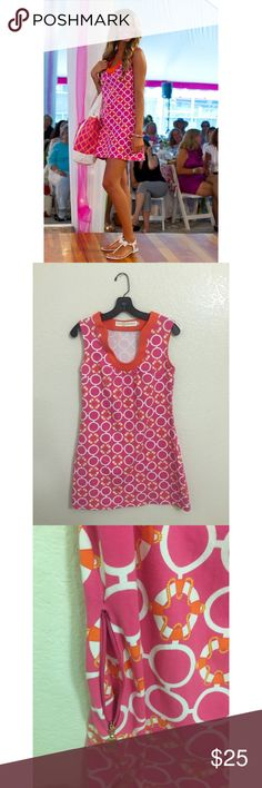 Pink and orange dress Mini dress in beautiful pink with a white pattern and orange border. Has a gold zippered pocket on one side. Comfortable material. Tracy Negoshian Dresses Mini