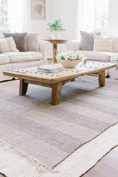 Coastal Farmhouse Living Room - Neutral Living Room - Sherwin Williams Alabaster - Layered Rugs - Slipcovered Sofa - Cream Couch - Modern Farmhouse - Interior Design - Large Light Fixture in Living Room Home Decor Trends, Popular Interiors, Farmhouse Rugs, Decor, Trending Decor, Trendy Living Rooms, Farm House Living Room, Farmhouse Rugs Living Room, Living Room Reveal