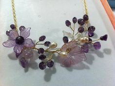 Beautiful wire wrap jewelry Necklace - freshwater pearls, amethyst natural stones, Czech glass beads, acrylic.. $29.99, via Etsy.
