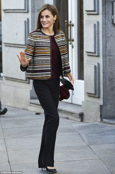 Queen Letizia, pictured above, stepped out this morning to attend a conference on the 'Inf...