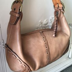 """VINTAGE Coach Boho Hobo Handbag Authentic Coach hobo in excellent vintage condition.  Natural wear on leather and the camel patina has aged beautiful.  Inner Signature lining.  Ask any questions.... Measures 15""""W x 10""""L.  Note: due to age, there are a couple of scratches.  See photos. SAVE 10% INSTANTLY ON ANY 2 ITEMS AND PAY ONE SHIPPING PRICE USING THE NEW SELF BUNDLE OPTION! Coach Bags Hobos"""
