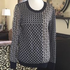 Adorable Joie Patchwork Sweater The detailing on this adorable patchwork sweater is beautiful. Colors of navy and Creme made out of a rayon, nylon, wool, cashmere blend. This sweater feels like heaven on,, super soft! Joie Sweaters Crew & Scoop Necks
