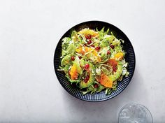 Pomegranate, Avocado, and Citrus Brussels Sprouts Salad | Shredded Brussels sprouts are a great canvas for color, here in the form of ruby-hued pomegranate seeds and navel orange sections. Be sure to toss the salad gently so that the pieces of orange and avocado keep their shape. If you don't have a shallot, you can substitute finely chopped red onion; soak for a few minutes in cold water first to remove its sometimes-pungent bite. This salad would pair nicely with a fall chili or tacos.