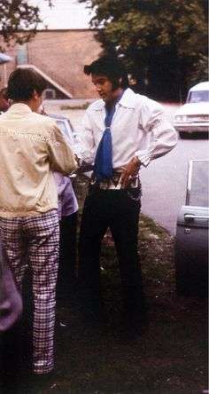 Nashville, TN, Friday, June 5, 1970: Elvis Presley is pictured stepping out of a car at RCA Studio B's parking lot on his way to the studio's back entrance. Elvis and his band recorded 35 masters over the five-day session (June 4 - June 8). Most of the songs found their way on one of three albums: Elvis Country (I'm 10,000 Years Old), That's the Way It Is, Love Letters from Elvis. Also see this photo: https://www.pinterest.de/pin/380906080965341111/