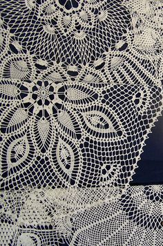Incredible hand-crocheted table covers. Art from string and artistic imagination.