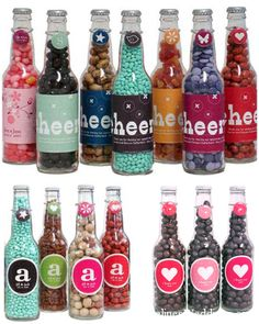 Empty soda bottles filled with candy for favors