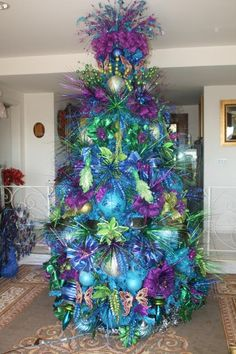 "Stunning christmas trees | Vickerman Co. 96"" Artificial Christmas Tree with Teal Lights in Sky ..."