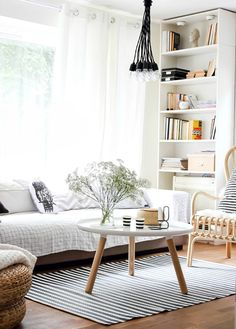Beautiful Scandinavian living room. Tall book case, black and white accents