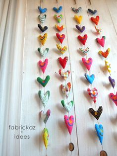 This is a cool wall hanging... one or several.  But without the painted on smiley faces... just the hearts.  So colorful.
