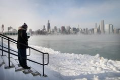 Mist rises from Lake Michigan as temperatures dipped well below zero on January 6, 2014 in Chicago, Illinois. Chicago hit a record low of -1...