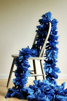 DIY Festooning: You will need (for one 7.5 foot garland): 4 folds of crepe paper, stapler, scissors