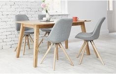 Upgrade your living space with this designer 4 seater dining set with upholstered grey bucket chairs!