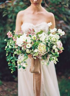 Lush garden wedding bouquet with trailing ribbon.