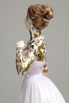 Innocent and traditional porcelain dolls that become modern day painted ladies by Jessica Harrison