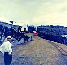 """The waterfront side of Astor's house on Ferry Reach, Ferry Id., St.George's, Bermuda. The train in the distance is on his private miniature railway line (18"""" gauge) which ran from his house to meet the then Bermuda Railway on the North Shore side of Ferry Id. The train is being pulled by his """"Mainliner"""" steam locomotive. Acknowledgement: Bermuda National Museum."""