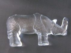 This is a Kosta Boda rhinoceros figurine from Sweden. I have never seen these before. They're unique. The back of the Rhino is flat. The front has all the detail. It measures 5 1/2 inches long and stands almost 3 inches high at the shoulder. There are no chips or cracks. price is $30 + $7 shipping    ---want---