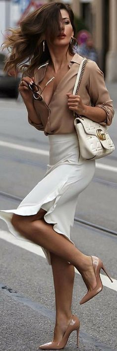 Beige blouse with white ruffled skirt.