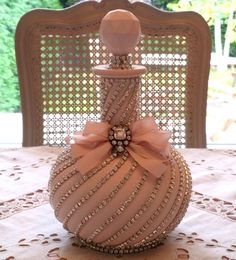 I wonder what kind of bottle that is. Liquor Bottle Crafts, Diy Bottle, Bottle Art, Bedazzled Liquor Bottles, Vintage Perfume Bottles, Bottles And Jars, Glass Bottles, Decoration Shabby, Glamour Decor