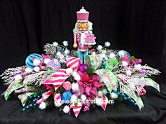 Whimsical Nutcracker Christmas Centerpiece, Candy Floral Table Decoration, Pink Lime Teal Cupcake Holiday Decor, Candy-land Arrangement by Azeleapetals on Etsy https://www.etsy.com/listing/166570834/whimsical-nutcracker-christmas