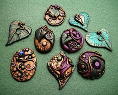 Purple Green and Gold assorted Cabochons by MandarinMoon, via Flickr