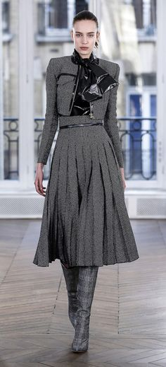 11e9e680b68b6 Black and white tweed structured jacket and high-waisted plissé skirt